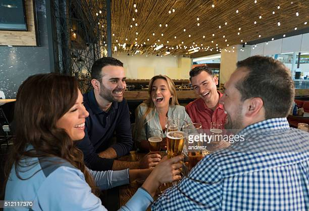 Group of friends drinking at the bar