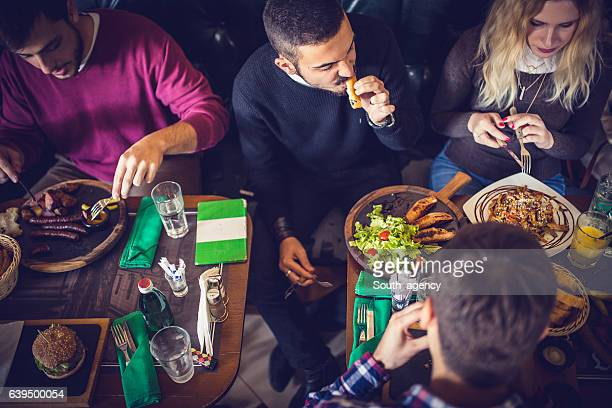 Group of friends eating