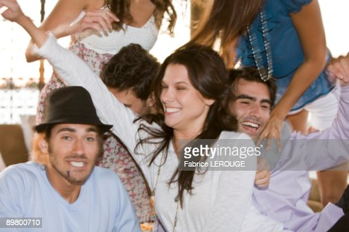 Group of friends enjoying at a party : Stock Photo