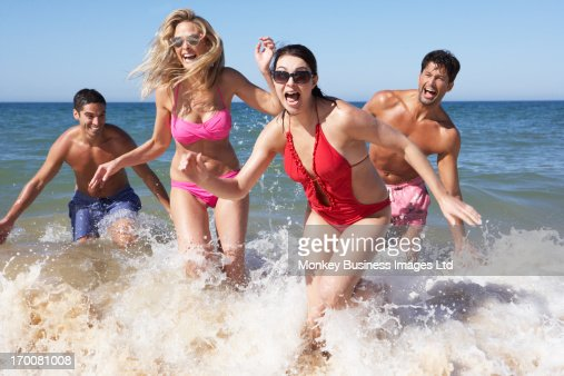 Group Of Friends Enjoying Beach Holiday : Stock Photo