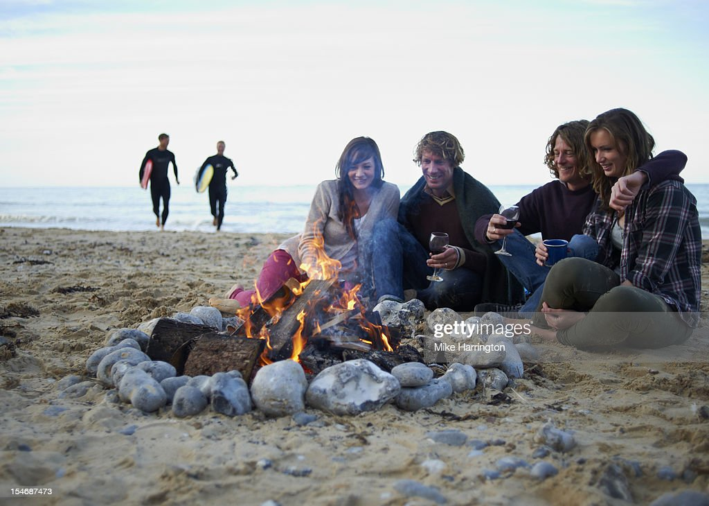 Group of friends enjoying beach party. : Stock Photo