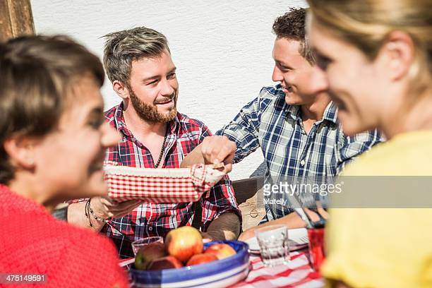 Group of friends enjoying breakfast together outdoors