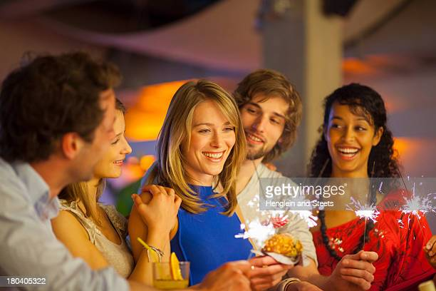 Group of friends enjoying cocktails in bar