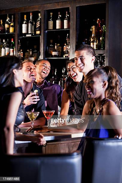 A group of friends enjoying drinks at bar