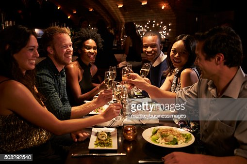 Group Of Friends Enjoying Meal In Restaurant : Stock Photo
