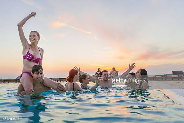 Group of friends enjoying the pool party
