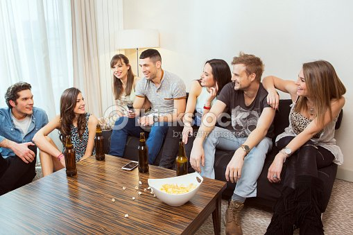 Group Of Friends Hanging Out At Home Stock Photo | Thinkstock
