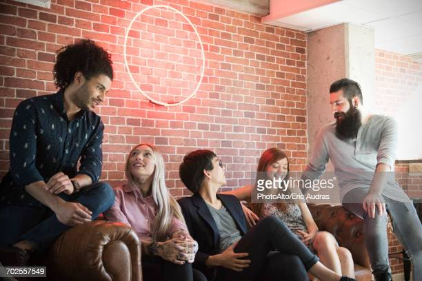Group of friends hanging out on sofa
