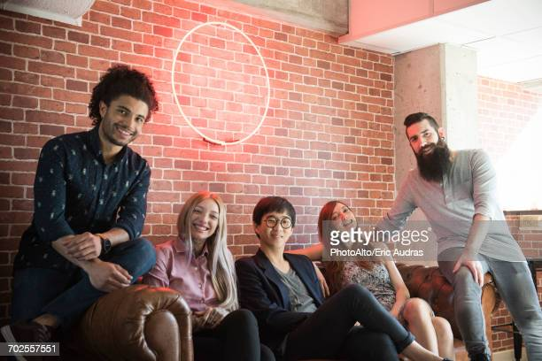 Group of friends hanging out on sofa, portrait