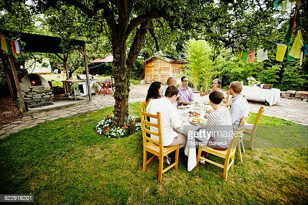 Group of friends having a backyard dinner party