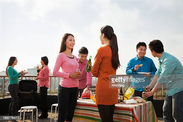 Group of Friends Having a Barbeque on a Rooftop