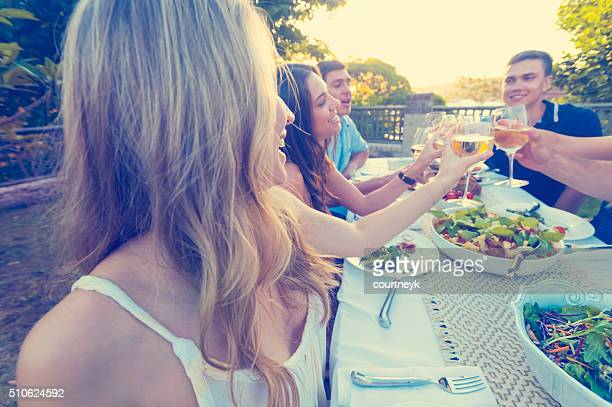 Group of friends having a meal outdoors.