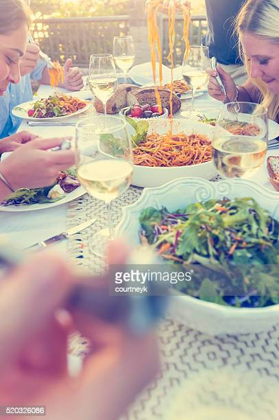 Group of friends having a meal outdoors