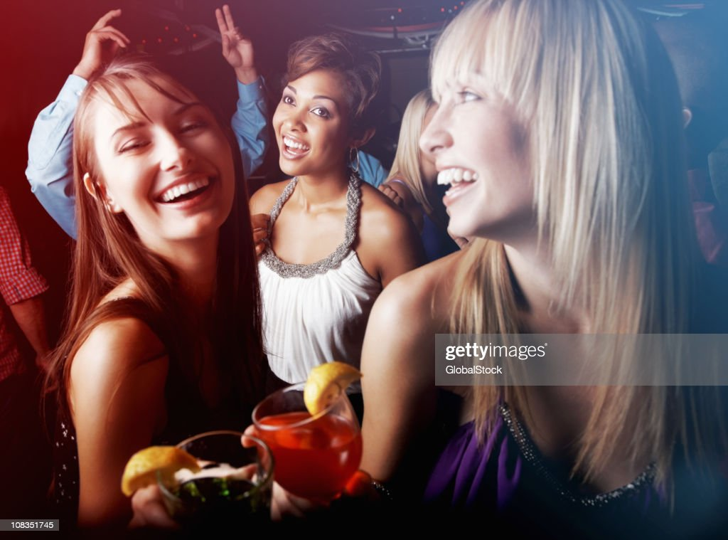 Group of friends having cocktail and enjoying at nightclub : Stock Photo