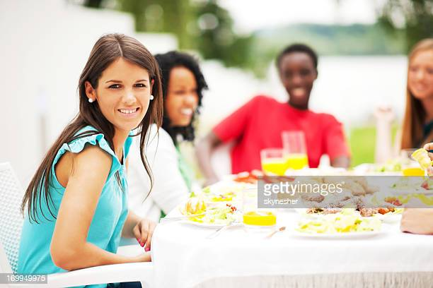 Group of friends having dinner outside