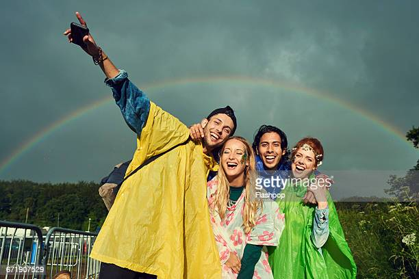 Group of friends having fun at a music festival