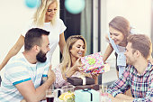 Picture showing group of friends having fun at birthday party