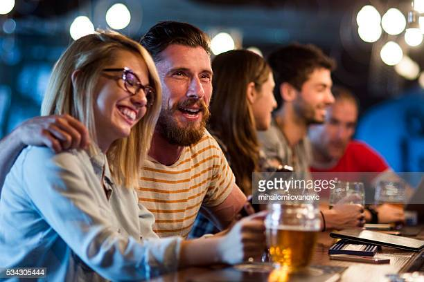 Group of friends having fun at the bar