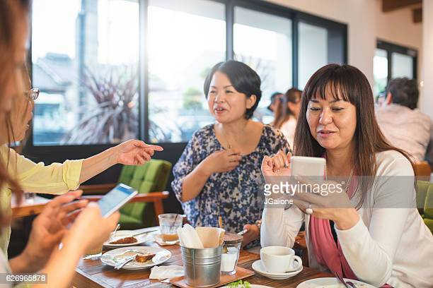 Group of friends having fun in a cafe