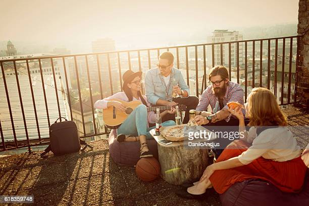 group of friends having fun on top of the city