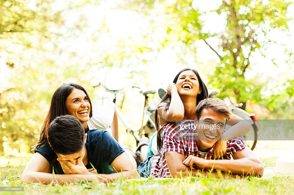 Group of friends having fun outdoors : Stock Photo