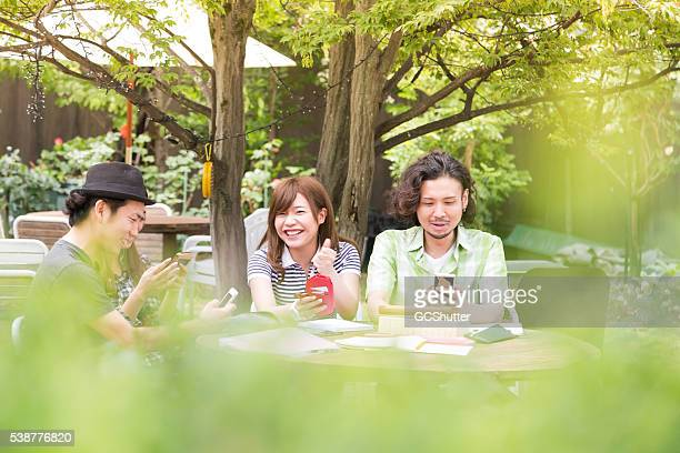 Group of friends having fun with their smartphones