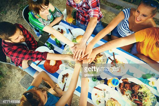 Hand holding a beer bottle stock photos and pictures for Group lunch