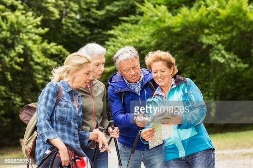 Group of friends, hiking, looking at map