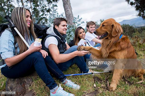 Group of friends hiking with a dog