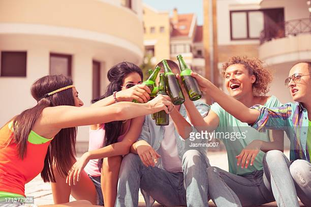 Group of friends holding beer bottle outdoors