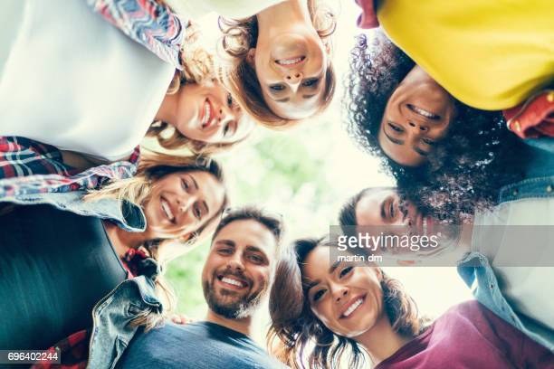 Group of friends in a circle smiling