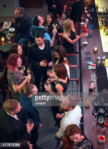 Group of friends in bar having drinks