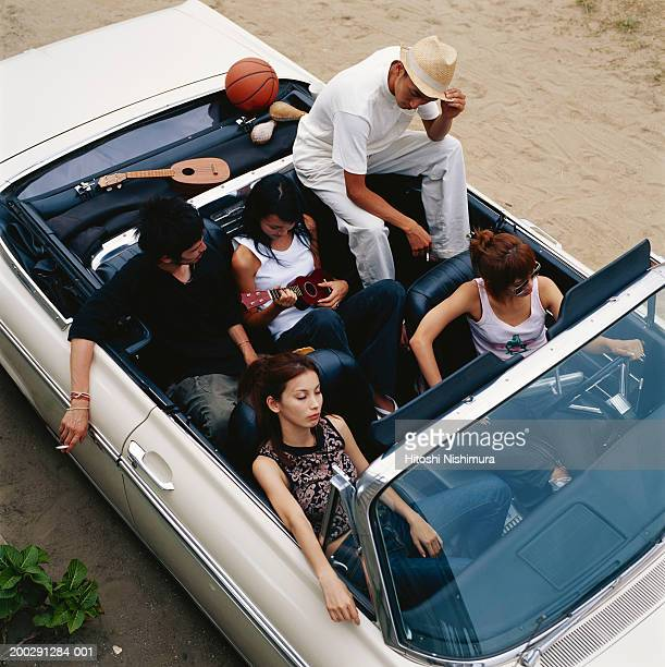 Group of friends in convertible car, elevated view