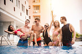 Group of Friends in Swimsuit , Enjoy Pool Party on Holiday Summer - Recreation and Lifestyle Concept