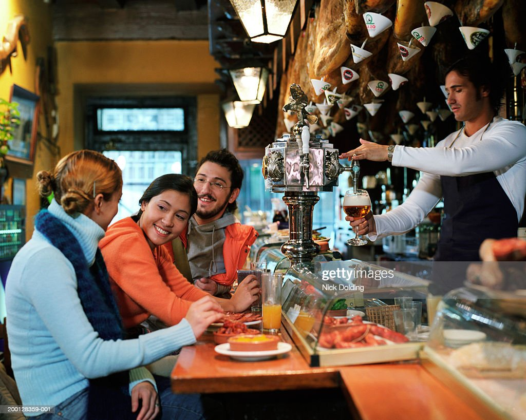 Group of friends in tapas bar : Stock Photo
