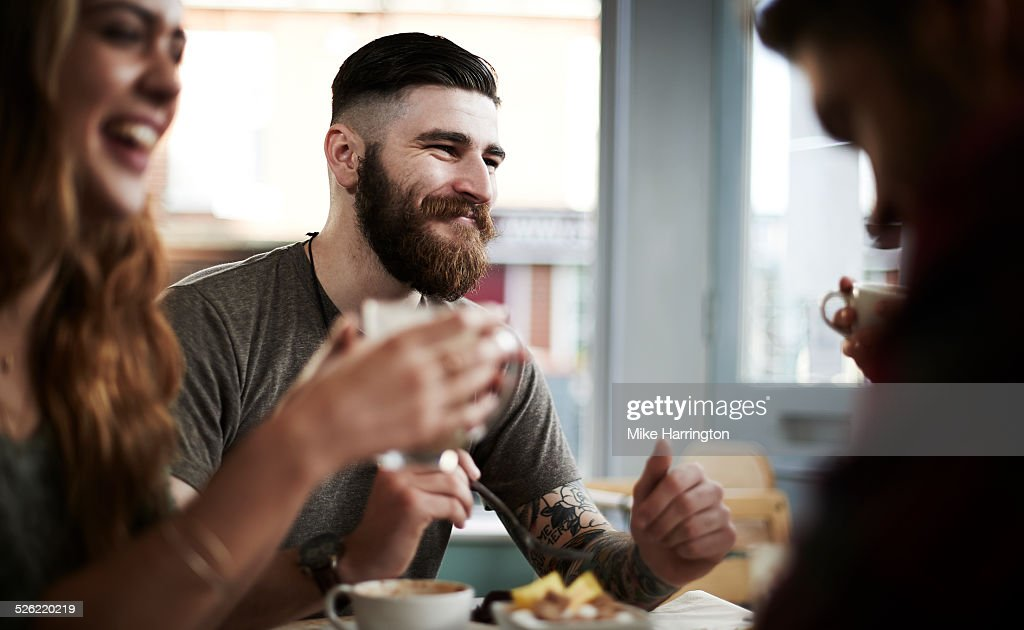 Group of friends in urban cafe : Stock Photo