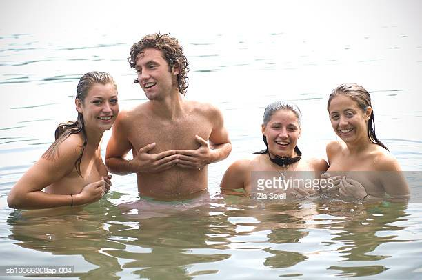 Group of friends in water, smiling