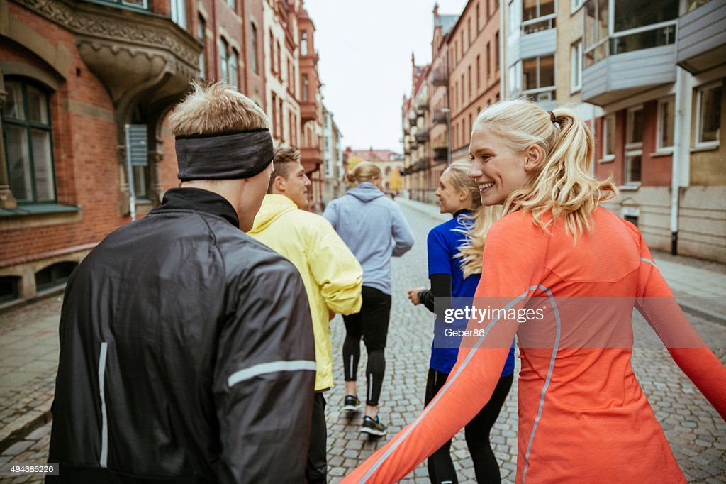 Group of friends jogging together