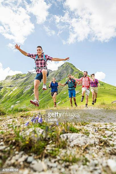 Group of friends jumping, Tyrol, Austria