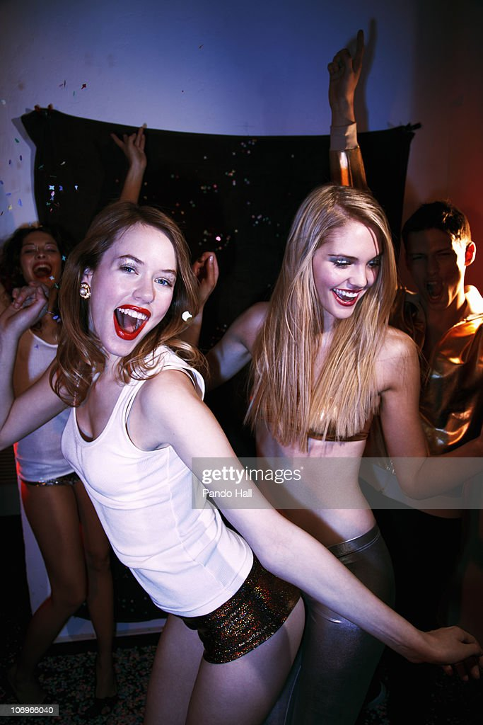 Group of friends laughing and dancing on a party : Stock Photo