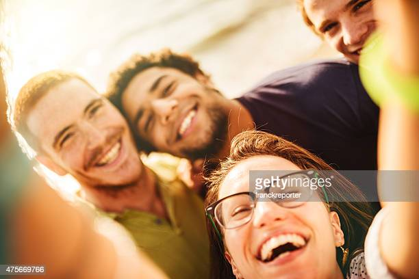 Group of friends laughing and doing a selfie
