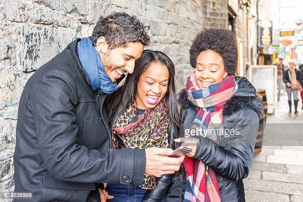 Group of Friends Laughing at a Mobile Phone