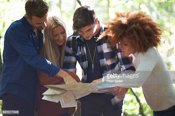 Group of friends looking at map together