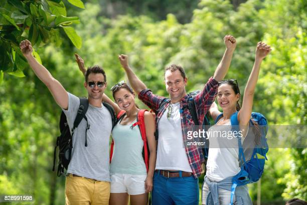 Group of friends looking very happy hiking outdoors