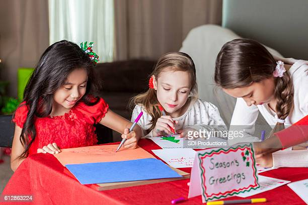 Group of friends make homemade Christmas cards