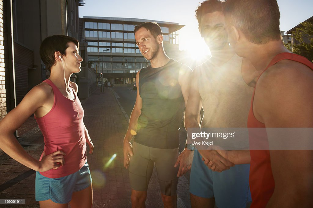 Group of friends meeting for evening run : Stock Photo