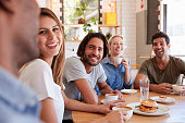 Group Of Friends Meeting For Lunch In Coffee Shop