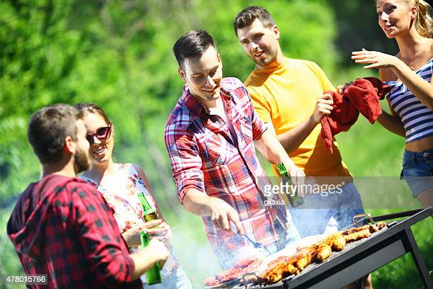 Group of friends on a barbecue picnic.