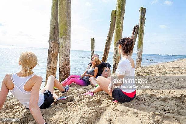 Group of friends on beach taking a break