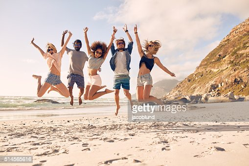 Group of friends on the beach having fun : Stock Photo